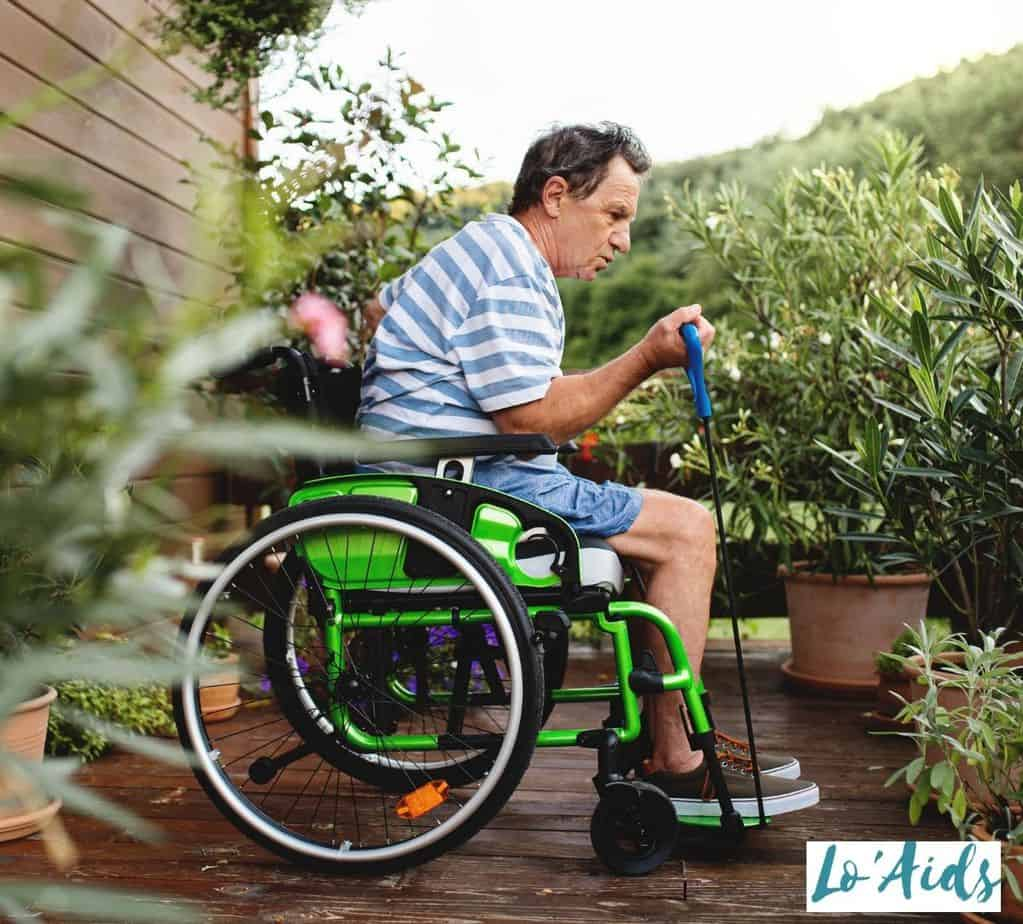 a man doing some wheelchair exercises for seniors in his terrace