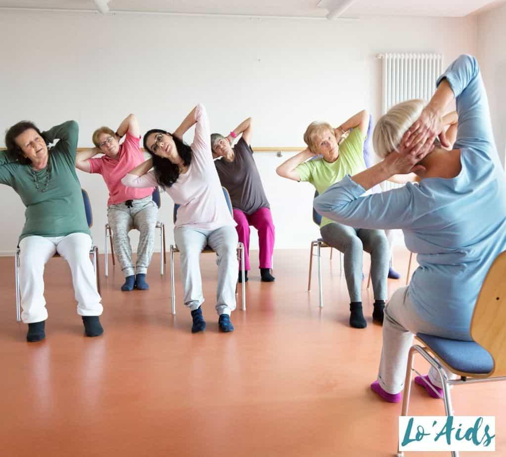 women having chair seated yoga exercises
