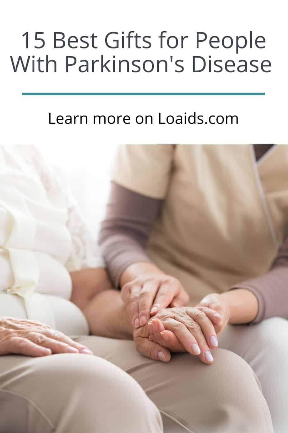 nurse holding senior woman's hand with tremor