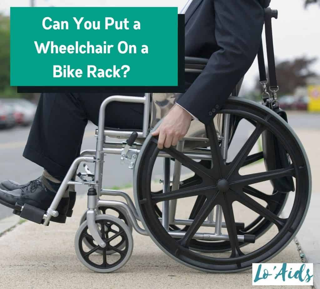 a man in a wheelchair parked at the side walk: Can You Put A Wheelchair On A Bike Rack?