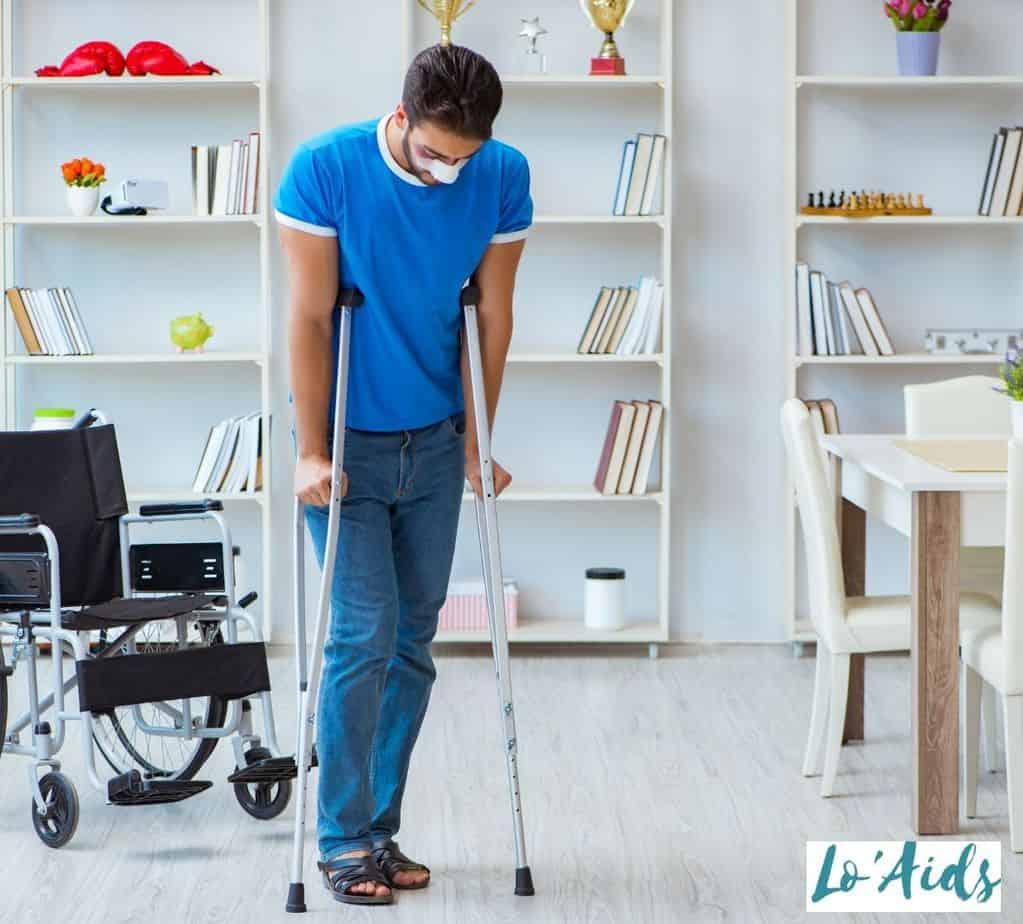 an injured man using crutches