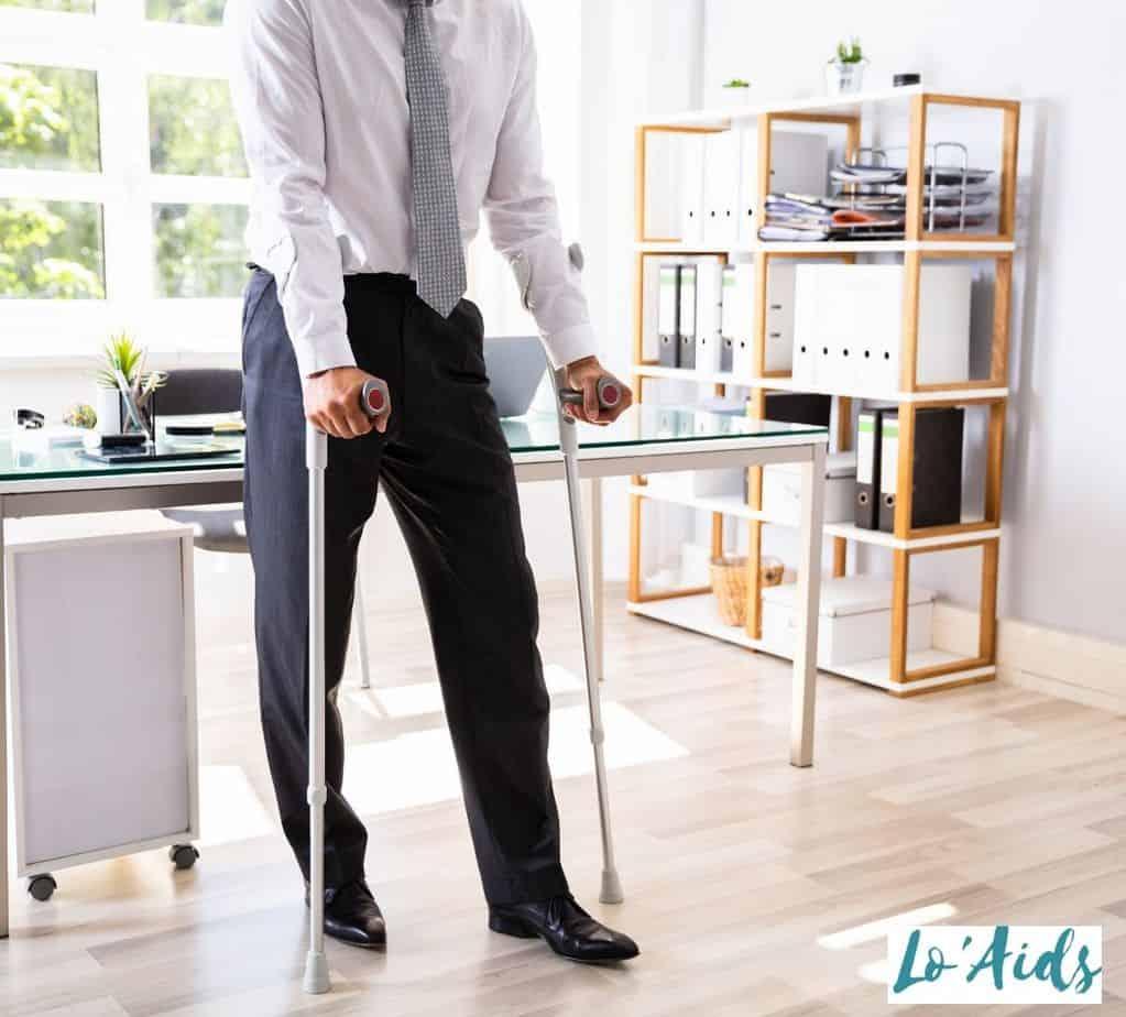 a business man using crutches
