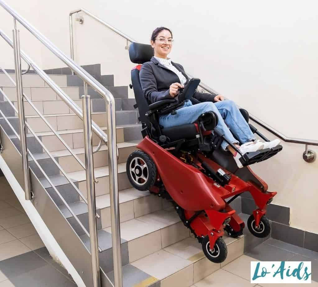 lady happily using a wheelchair that climbs stairs
