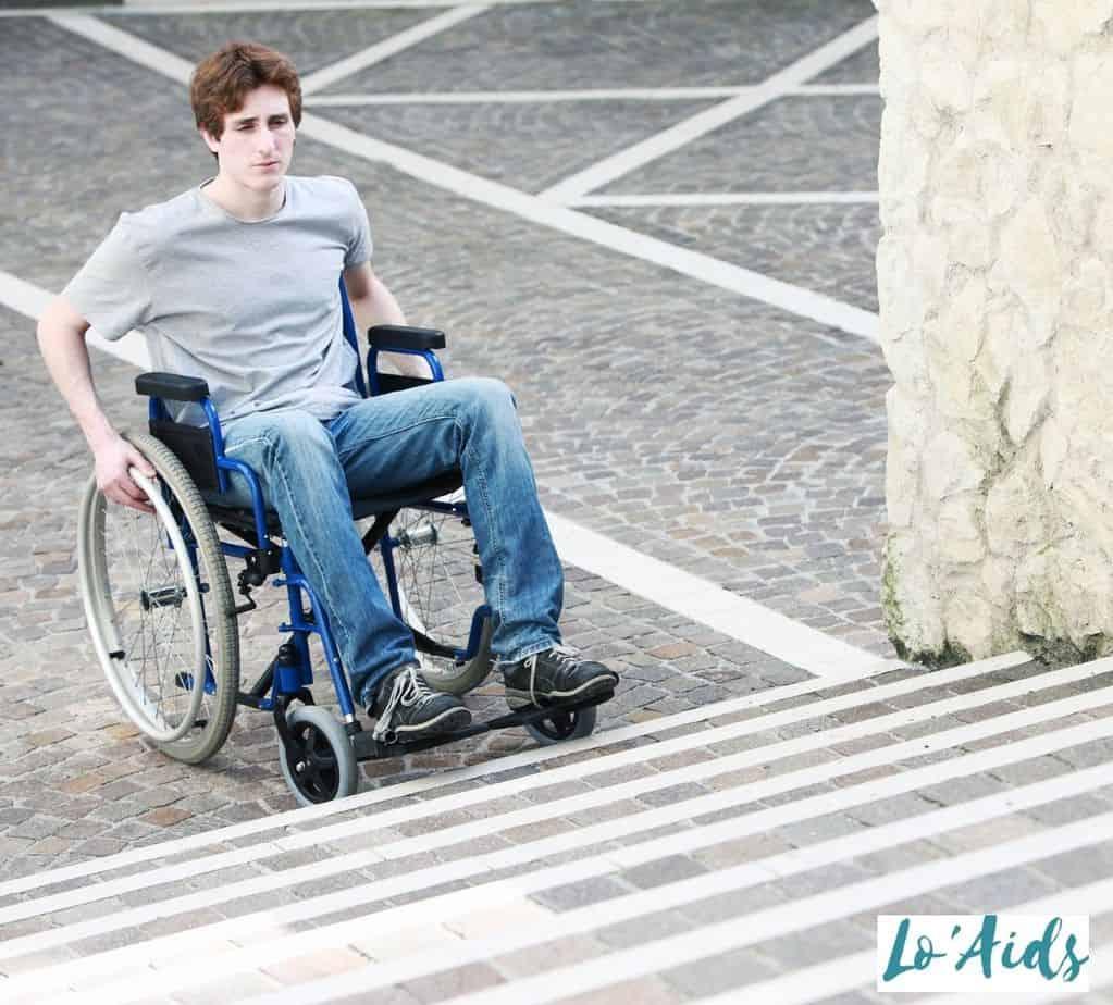 a man in a wheelchair about to climb a stair