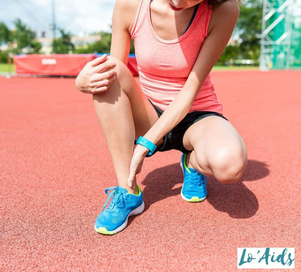 an athlete holding her sprained ankle but when to wear a brace for ankle sprain?