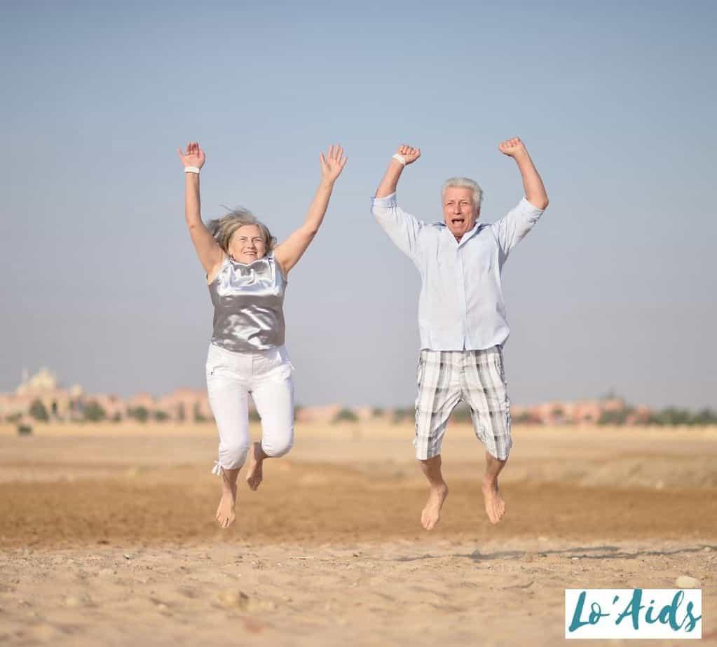 senior couple jumping in the desert
