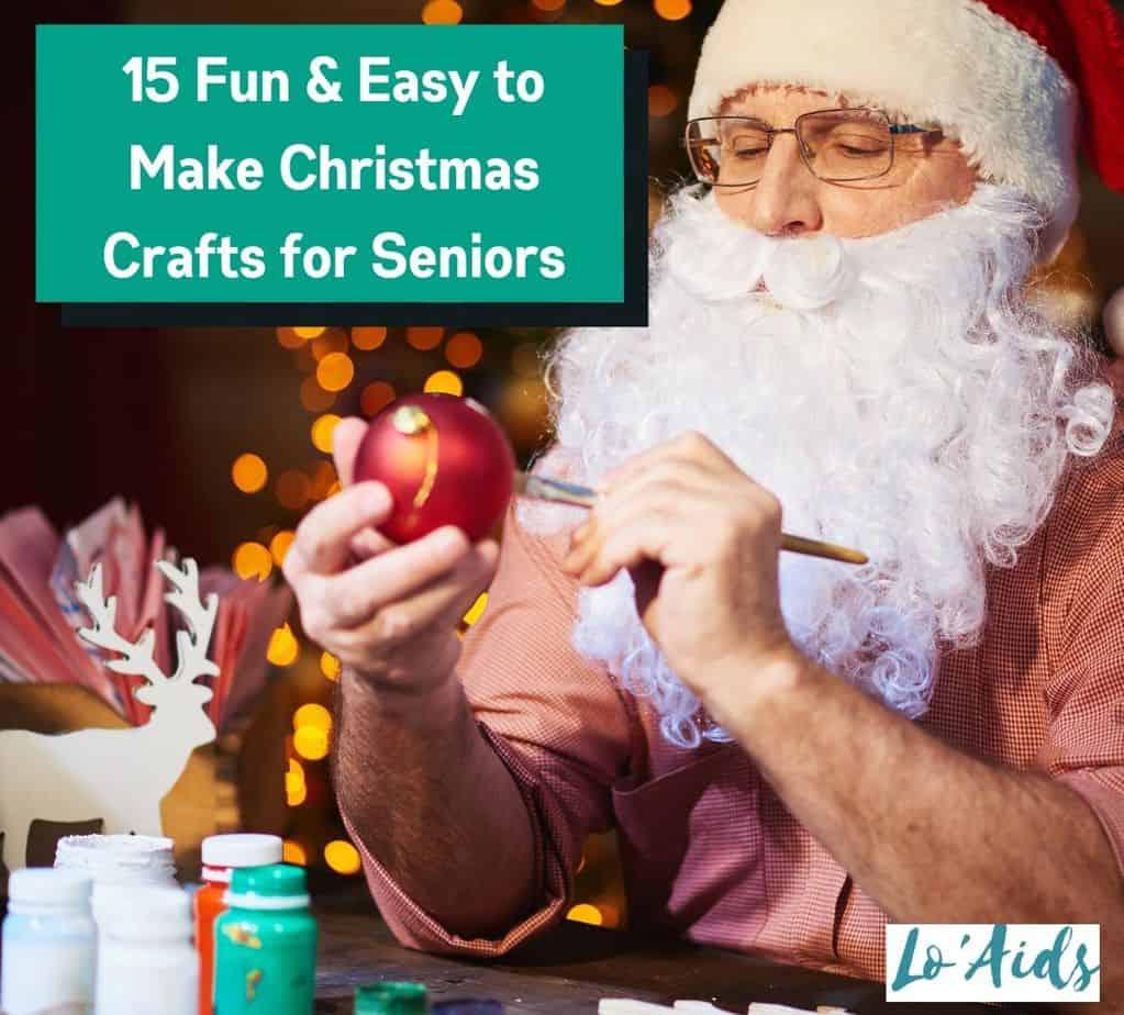 Santa-costumed senior man making Christmas crafts for seniors
