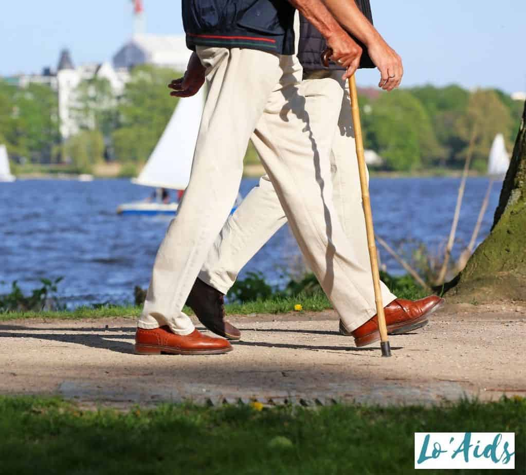 man walking with his wooden cane