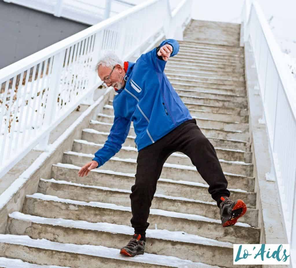 senior losing his balance on the staircase