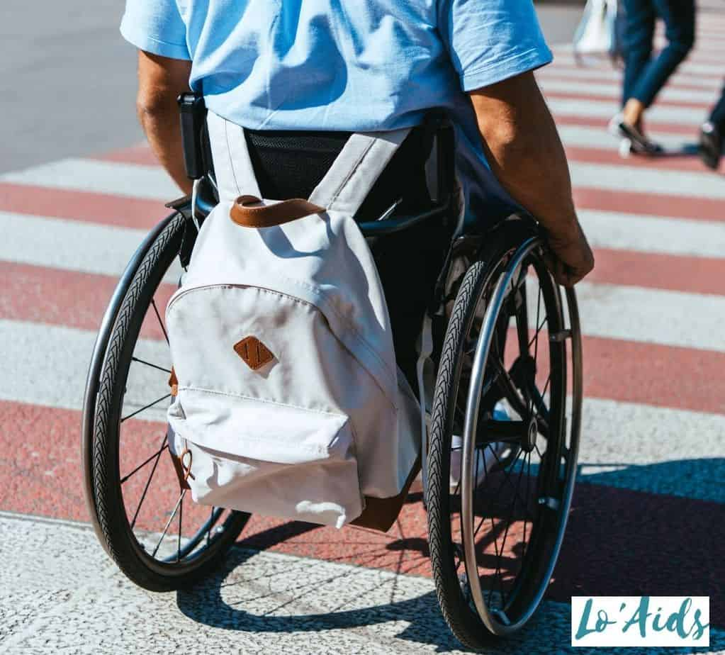 man in his wheelchair using the best wheelchair backpacks
